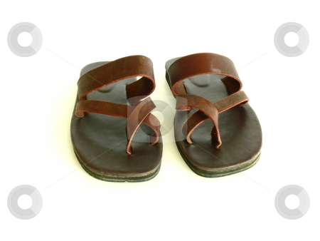 Leather sandals stock photo, A pair of flat, brown leather sandals. Toes to viewer. Isolated on white. by Martin Darley