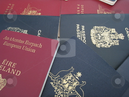 Passports stock photo, A selection of passports from Australia, Canada and Ireland by Martin Darley