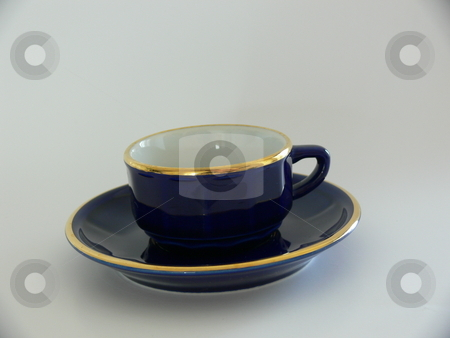 Coffee Cup stock photo, A dark blue gold-rimmed espresso cup sitting on a matching saucer. Isolated on a grey/white background by Martin Darley