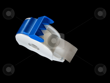 Medical Tape stock photo, Medical sticking plaster in a dispenser. Isolated on black. by Martin Darley