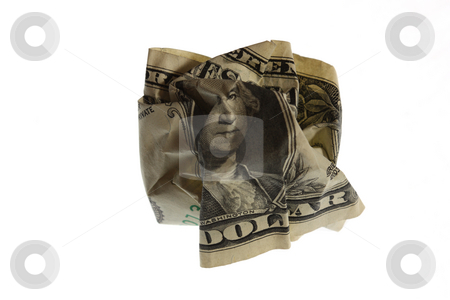 Crinkled Dollar stock photo, The crinkled Dollar symbolises financial difficulties. by Gyozo Toth
