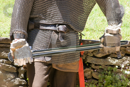 Medieval Warrior stock photo, A medieval warrior in chain mail holding a sword by Nicholas Rjabow
