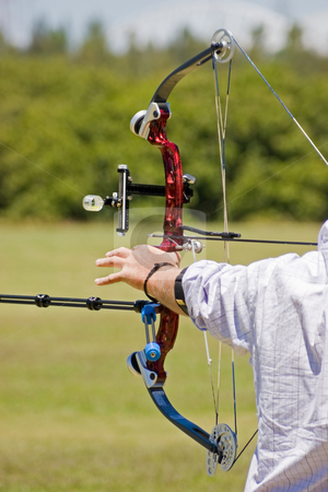 Archer and Bow stock photo, An archer pulling on the string of his bow by Nicholas Rjabow