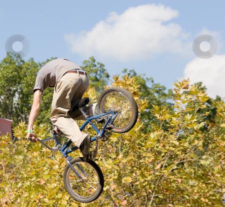 BMX Biker stock photo, A bMX biker in a aerial stunt by Nicholas Rjabow