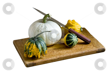 Still life of garden harvest stock photo, Gourds arranged on a cutting board with knife by RCarner Photography
