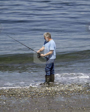 Point no Point park stock photo, August 17, 2004 :  A fisherman tries his luck catching a Salmon at the Point no Point park in Hansville, Washington. by Jesse Beals