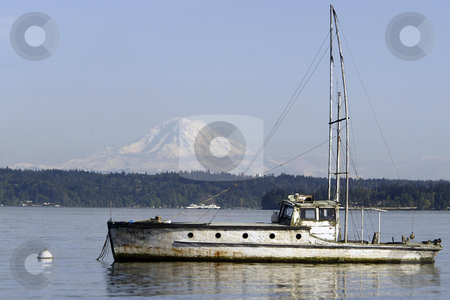 Old fishing vessel stock photo, April 22, 2004:  A old fishing vessel sits in the Manchester marina of Port Orchard, Washington.  On a clear day you can see Mt. Rainier behind it. by Jesse Beals