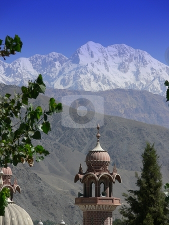Mosque in the mountains stock photo, Tirich Mir, The highest mountain in the Hindu Kush, dominates the Pakistani city of Chitral by Martin Darley