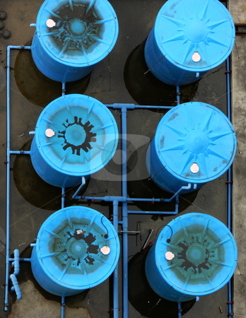 Rootop water tanks stock photo, Blue, industrial sized rooftop water tanks, shot from above by Martin Darley