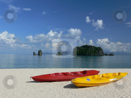 Island hopping stock photo, Brightly coloured sea kayaks on a perfect beach. Langkawi Island, Malaysia by Martin Darley