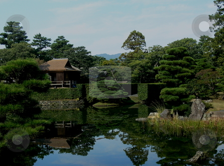 Kyoto Imperial Palace Garden stock photo, The immaculate Kyoto Imperial Palace Garden, reflected in a pond. Kyoto, Japan by Martin Darley