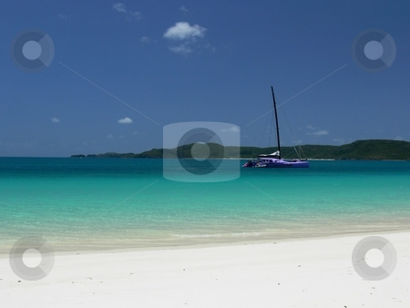 Anchored in Paradise stock photo, A catamaran anchors in the azure sea, just off a perfect white beach. Whitehaven Beach, Whitsunday Island, great Barrier Reef, Queensland, Australia by Martin Darley