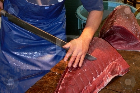 Tuna Becomes Sashimi stock photo, A fishmonger slices a huge tuna using an equally huge traditional Japanese knife. Tokyo fish market. by Martin Darley