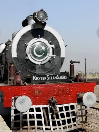 Locomotive stock photo, The Khyber Steam Locomotive with Pakistani flag on its front face. by Martin Darley