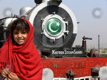 Khyber Pass Welcome stock photo, A young girl welcomes the Khyber steam train on one of its stops in the tribal areas en-route from Peshawar to Landi Kotal, Northwest Frontier Province, Pakistan. by Martin Darley