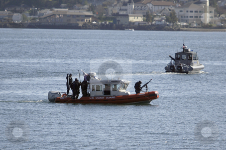 The United States Coast Guard stock photo, March 3, 2004 : The United States Coast Guard ran through terrorist drills in the Sinclair Inlet waters in front of the Bremerton Navy shipyard in Bremerton, Washington. by Jesse Beals
