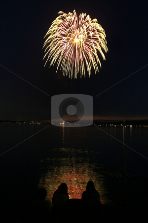 4rth Of July Fireworks stock photo, July 23,2004 :  On lookers watched from the beach of the Silverdale Hotel as the Whaling Days fire work show lit up the sky in Silverdale, Washington. by Jesse Beals