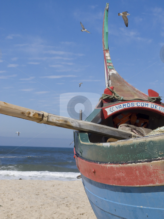 Fisherman boat on the sand stock photo, Fisherman boat waiting to go to the sea. We can read