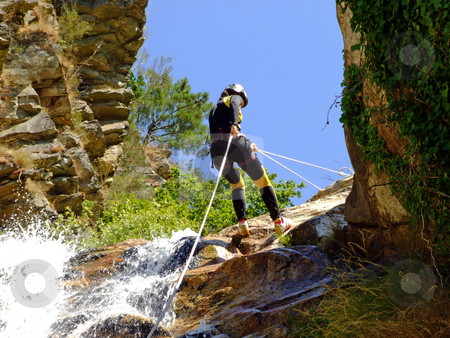 Woman descending on rappel  stock photo, Canyoning on the Teixeira river in Portugal by Paulo Resende