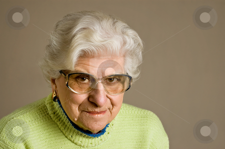Senior lady portrait, smiling. stock photo, Senior lady portrait, smiling, glasses, with copy space. by Pablo Caridad