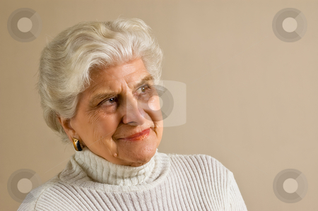 Senior lady portrait, smiling, with copy space. stock photo, Senior lady portrait, smiling, with copy space. by Pablo Caridad