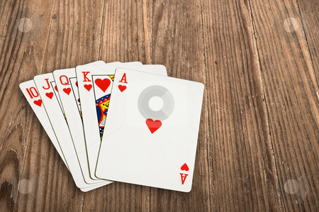 Poker cards over an old wooden table. stock photo, Close up shot of poker cards over an old wooden table. by Pablo Caridad