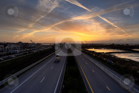 High road stock photo, Highway in the sunset by Paulo Resende