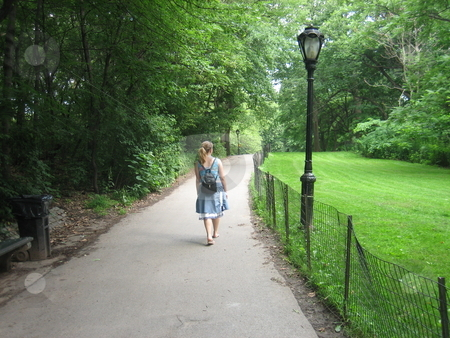 Lady in Central park stock photo, A lady in Central Park, New York by Tom Falco