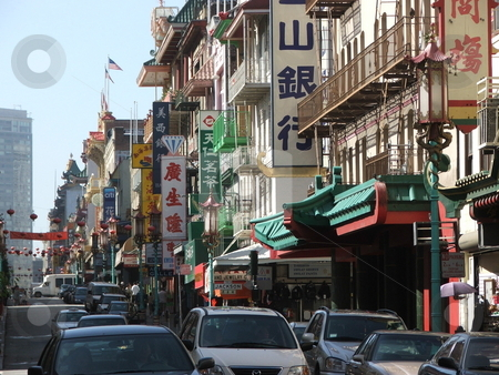 San Francisco Chinatown Street Scene stock photo, LIKE ANOTHER WORLD - San Francisco's Chinatown, a popular tourist destination, is about eight blocks long and primarily located on Stockton and Grant Avenues between Bush and Columbus.  Chinatown was rebuilt after the 1906 earthquake and it's architecture is an odd mix of Edwardian and Chinese design.  Dragon streetlights and Chinese signs on Grant Avenue help give the impression one has entered a different world. Souvenir shops abound along this busy street (photo April, 2007). by Dennis Thomsen