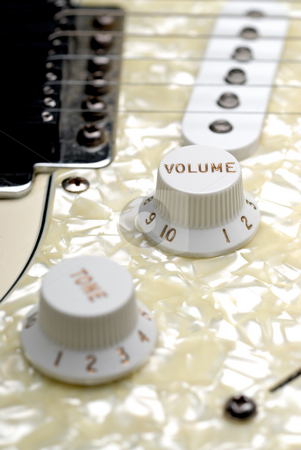 Guitar volume control stock photo, Closeup of a guitar volume control knob by Vince Clements