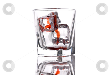 Glass with bloody ice cubes stock photo, Glass with bloody ice cubes by Vince Clements