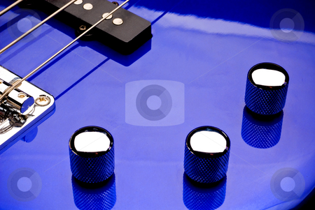 Bass guitar volume and tone knobs stock photo, Macro of Bass guitar volume and tone knobs by Vince Clements