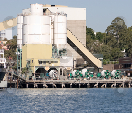 Cement Trucks and Silos stock photo, A cement depot on the water by Nicholas Rjabow