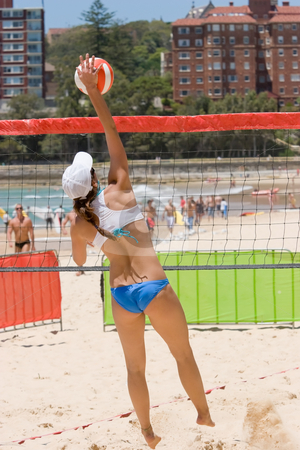 Beach Volleyball stock photo, A beach volleyball player spiking by Nicholas Rjabow