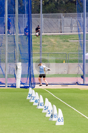 Hammer Throw stock photo, An athlete competing in the hammer throw event by Nicholas Rjabow
