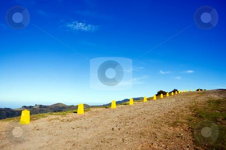 Yellow posts in Madeira mountains  stock photo, Yellow restrictive posts in Madeira mountains by Vitaly Sokolovskiy