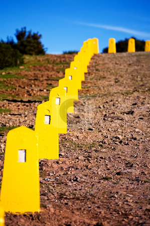 Yellow restrictive posts in Madeira   stock photo, Yellow restrictive posts in Madeira mountains by Vitaly Sokolovskiy