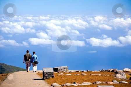 Couple going on road to blue sky in Madeira Island stock photo, Couple going on road to blue sky in Madeira Island, Portugal by Vitaly Sokolovskiy
