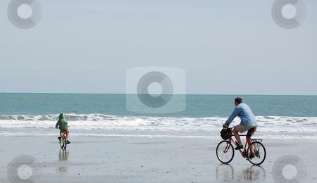 Biking Along The Beach stock photo,  by Liane Harrold