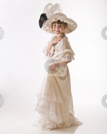 Dressing up in period clothes stock photo, Little girl having lots of fun with old dresses by RCarner Photography