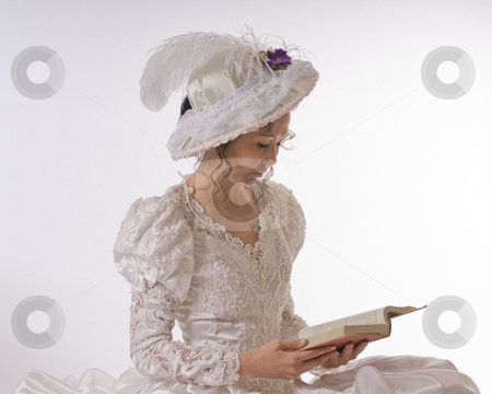 Young lady reading stock photo, Young woman dressed in period clothes by RCarner Photography