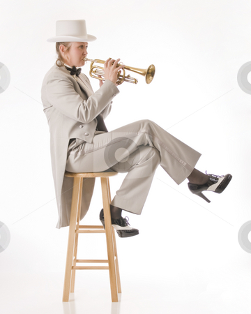 Jazz on a stool stock photo, Woman poses with her trumpet while wearing a tuxedo by RCarner Photography