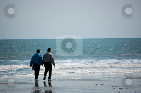 Walking Along The Beach stock photo,  by Liane Harrold