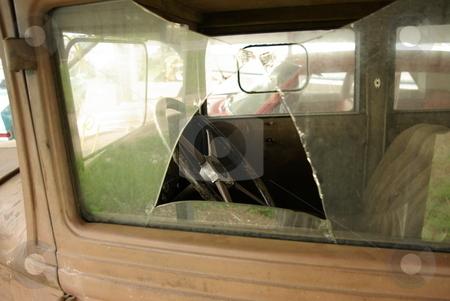 Broken Window stock photo, Broken Window - A broken windown shows the hard times behind this vintage 1930 Chevrolet hiding under a carport in Jenkins, MN. by Dennis Thomsen