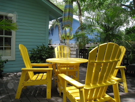 Yellow chairs sunny patio stock photo, Yellow patio furniture at Art colony in Sarasota, Florida by Tom Falco