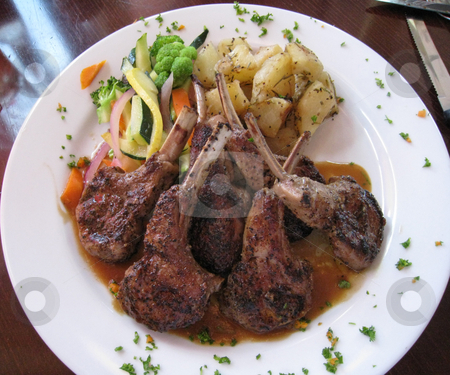 Lamb chops at restaurant stock photo, Lamb chops at restaurant dinner by Tom Falco