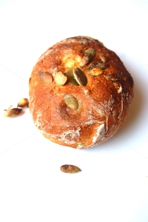 Bread Roll stock photo, A single bread roll with pumpkin seeds on a white background, no flash used, daylight by Lars Kastilan