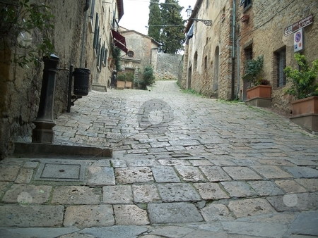 Narrow Street In a Historic Town In Italy stock photo, A narrow street in the historic town of Volterra in italy. by Andy C