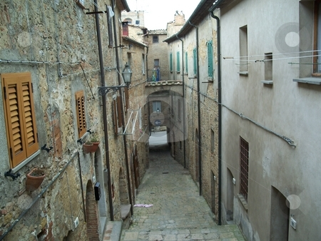 A Historic Narrow Street In Volterra Italy stock photo, I picturesque photo of a narrow street in volterra italy. by Andy C