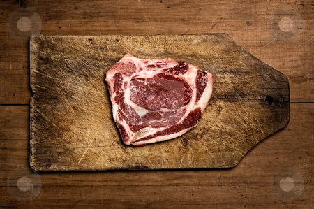 Steak on wooden table. stock photo, Steak on wooden table. by Pablo Caridad